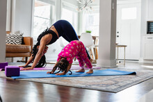 Mother And Daughter Does Exercise Yoga Together, Downward Dog