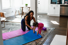 Toddler Joins Mother Workout Exercise With Yoga Mat