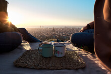 Gay Men With Coffee Cups Sitting On Observation Point Against Clear Sky, Bunkers Del Carmel, Barcelona, Spain