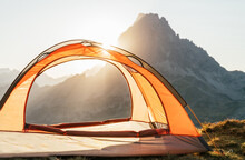Modern Camping Tent Placed On Hill In Highland Terrain On Background Of Sunrise In Pyrenees Mountains