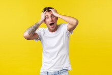 Lifestyle, Summer And People Emotions Concept. Troubled Emotional Guy In White T-shirt, Tossing Hair And Looking Crazy Camera, Feeling Stressed-out, Panic Over Problem, Yellow Background