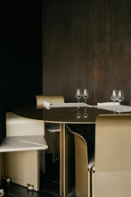 Interior Of Spacious Restaurant With Tables And Chairs In Row In Stylish Design