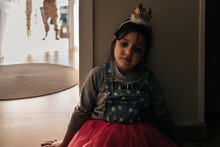 Little Hopeless Girl Wearing Festive Dress And Crown Waiting For Dad Coming From Military Service