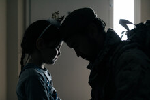 Side View Silhouette Of Upset Girl Touching Dad With Forehead While Seeing Off Dad To War