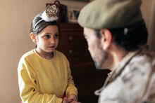 Military Father Holding Hands Of Small Girl Before Going To Defend Country