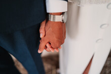 From Above Crop Faceless Newlywed Couple Wearing Elegant Clothes Holding Hands Tenderly During Wedding Ceremony