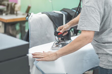 Ironing A Garment In Industrial Tailoring Production Line