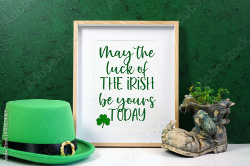 Canvas Print Happy St Patrick's Day vertical wood border picture frame, styled with leprechaun hat, shamrocks, and chocolate gold coins, on a textured green background