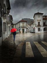 Red Umbrella In Urban Spain