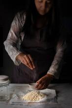Woman Salting - Cooking