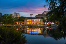 Evening Sunset Along The Spokane River In Riverfront Park, A Public Urban Park With Carousel And Events In The City Of Spokane, Washington, USA