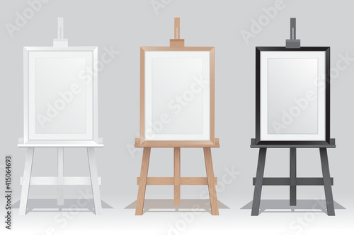 Photo Wooden easel stand with picture frame on white background