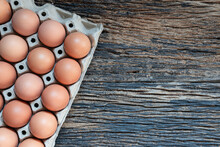 Open Egg Box With  Brown Eggs On Wood Background With Clipping Path. Fresh Organic Chicken Eggs In  Pack Or Egg Container With Copy Space