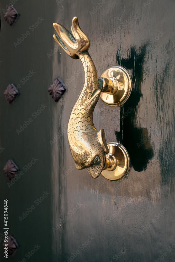 Fototapeta Vintage door handle in shape of dolphin, Malta