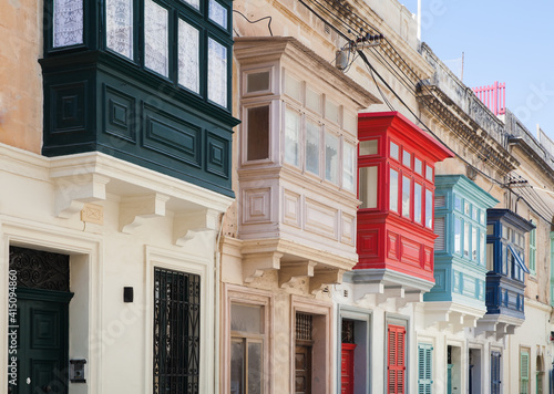 Fototapeta Street view with colorful old balconies. Living houses of Malta