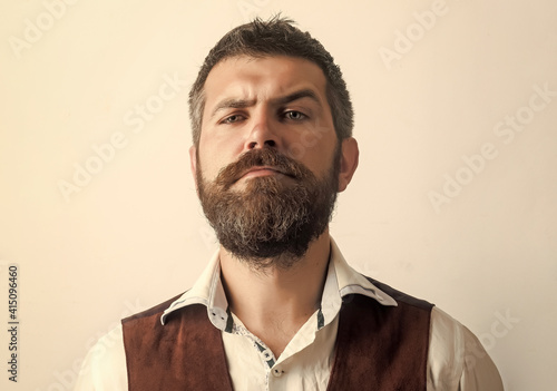 Fotografija Bearded man with long beard on serious face in shirt isolated.