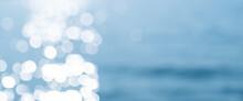 Lights On Sea Waves Background. Blur Summer Sparkling Sea Water.