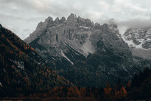 Majestic View Of Rocky Dolomites Mountain Range In Italy With Snow Patches And Colorful Foliage