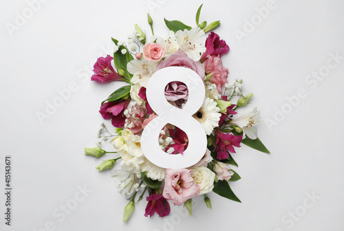 8 March greeting card design with beautiful flowers on white background, flat lay. International Women's day © New Africa