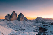 Sunset Over Tre Cime Di Lavaredo And Monte Cristallo Covered With Snow In Autumn, Dolomites, Border Of South Tyrol And Veneto