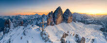 Summit Cross On Snow Capped Monte Paterno With Tre Cime Di Lavaredo In Background At Sunset, Sesto Dolomites, South Tyrol