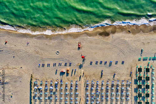 Photo Italy, Tuscany, Torre del Lago Puccini, boathouse and neatly ordered beach chair
