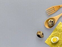 Quail Eggs On Waxed Napkin, Wooden Spoon And Fork, Easter Concept