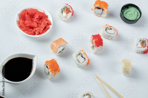 Fototapeta Variety of sushi rolls served with wasabi and soy sauce obraz