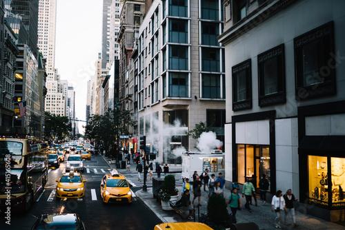 Fototapeta Narrow city street with traffic and pedestrians obraz