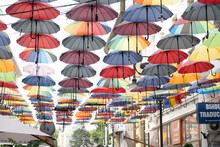 A Group Of Different Colored Umbrella In ROmania In Center Of Iasi Town In A Summer Day With Sun