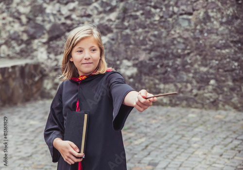 Tela young sorceress in the castle conjuring by magic wand