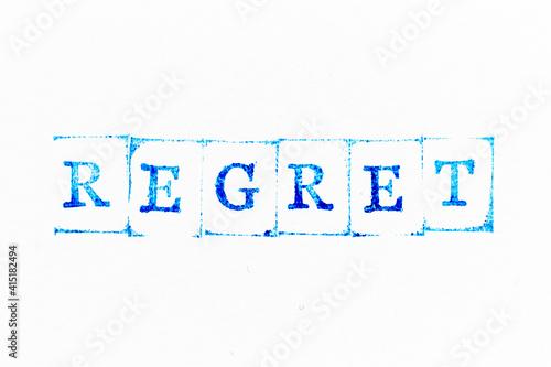 Fototapeta Blue color ink rubber stamp in word regret on white paper background