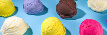 Colorful Various Ice Cream Scoops Pattern On Pastel Blue Background. Summer Minimalism Pattern Flat Lay With Hard Light. Chocolate Vanilla Blueberry Strawberry Pistachio Orange Ice-cream Balls Top Vie