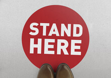 Social Distancing Concept.  Footprint Sign Red Color With Text Stand Here For The Print Floor.