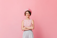 Romantic Short-haired Woman Looking At Camera. Studio Shot Of Girl In Beret Standing With Crossed Arms On Pink Background.