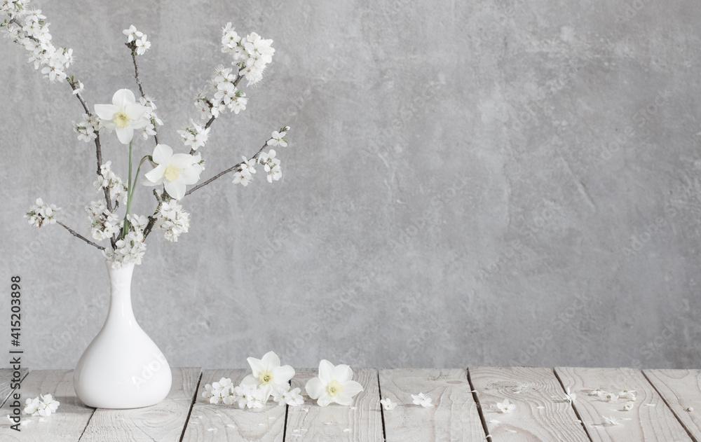 Fototapeta cherry flowers in white vase on background old gray wall