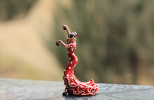 Figurine Of A Dancer On A Nature Background