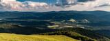 Fototapeta  - Szeroki widok na dolinę, w której leży górska miejscowość Wetlina, Bieszczady, Polska