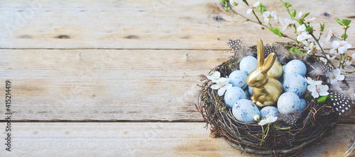 eggs in a basket on a wooden table - easter backgrounders banner