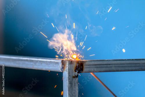 Fotografie, Obraz welding sparks, construction and metal work industrial concept, metal welding wi