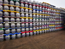 Alluminion Beer Kegs Stacked Up And Held In Place With Plastic Locaters