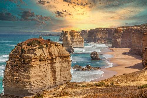Canvas Print Blue green ocean and beach with sandbanks cliffs and waves  with close view of T