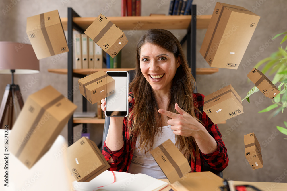 Fototapeta Woman does shopping through e-commerce online shop. Concept of fast delivery
