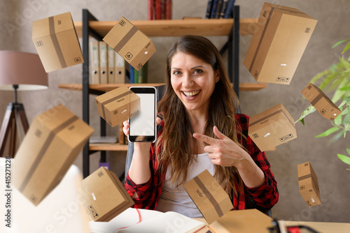 Fototapeta Woman does shopping through e-commerce online shop. Concept of fast delivery obraz