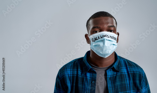 Papel de parede Close up portrait of young african american man wearing protective mask with ins