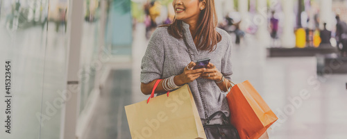 Stampa su Tela Banner cover of Asian woman using the smart mobile phone for check online shoppi