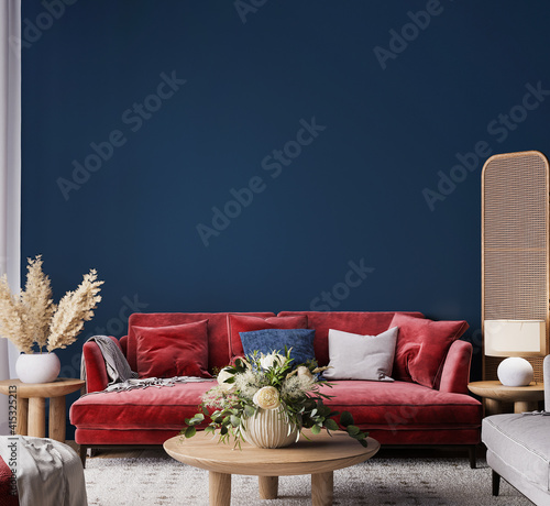 Fototapeta Living room interior mock-up with red sofa, wooden table and rattan home decoration in dark blue background, 3d render obraz