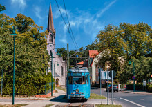 The Old German Tram In The Suburbs Of Berlin. An Old Town With A Cathedral.