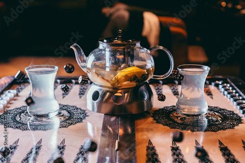 Fototapeta tea on the backgammon board