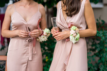 Beautiful Slender Bridesmaids Waiting For The Ceremony To Start. Wedding Look, Identical Dresses And Butannieres From Natural Flowers